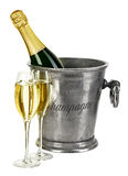 Bottle of champagne  in ice bucket with stemware isolated Royalty Free Stock Image