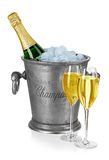 Bottle of champagne  in ice bucket with stemware isolated Royalty Free Stock Photos