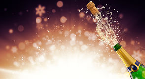 Bottle of champagne over fireworks background. Splashing bottle of champagne with flying cork over fireworks background. Celebration concept, free space for text Stock Photo