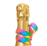 Bottle of champagne with party streamer Royalty Free Stock Photography