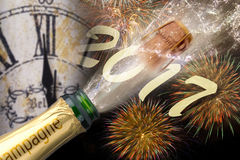 Bottle of champagne with popping cork. At new years 2017 Stock Images