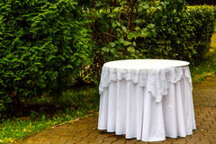 The bottle of champagne and snacks are on white round table in t Royalty Free Stock Photography