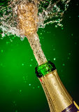 Bottle of champagne with splash Stock Photography