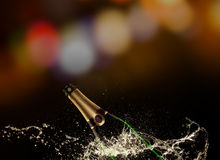 Bottle of champagne with splash Royalty Free Stock Images