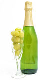 Bottle of champagne with twelve grapes Royalty Free Stock Image