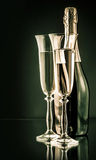 Bottle of champagne with two full glasses Stock Photography