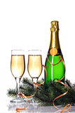 Bottle of champagne, two glasses and fir branch Royalty Free Stock Photography