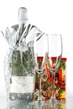 Bottle of champagne, two glasses and small gift Stock Photo