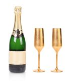 Bottle of champagne and two golden glasses. Stock Photo