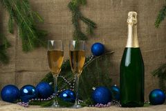 Bottle of champagne with two wine glasses on a background of bra stock photos