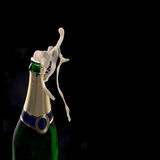 Bottle of champagne with wine explosion Royalty Free Stock Image