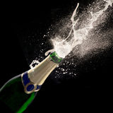 Bottle of champagne with wine explosion Stock Image