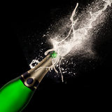 Bottle of champagne with wine explosion Stock Photo