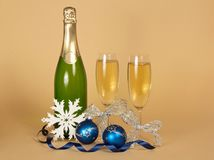 Bottle of champagne, and wine glasses with silver Stock Photo