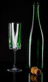 Bottle of champagne with wineglass Royalty Free Stock Photo