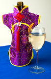 Bottle with Chinese wine, decorated with a purple kimono Royalty Free Stock Photography