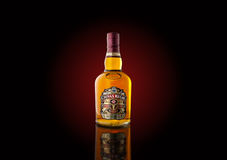 Bottle of `Chivas Regal` whiskey with dark red backlight Stock Image