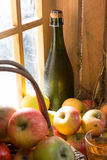 Bottle of cider with apples Stock Photo