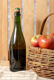 Bottle of cider with fresh apples Stock Photos