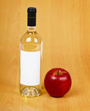 Bottle of cider on wooden table Royalty Free Stock Photo
