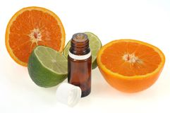 Bottle of citrus essential oil royalty free stock photos