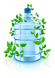 Bottle with clean blue water and green foliage Stock Images