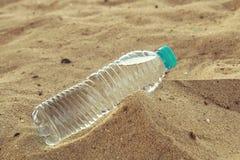 Bottle of clean drinking water in a dry desert, copy space. Bottle of clean drinking water in a dry desert, copy space stock images