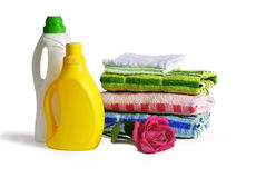 Bottle with cleaning solution, towels and rose Royalty Free Stock Images