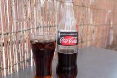 Geneva/Switzerland-28.07.18 : Glass bottle of Coca Cola sugar zero sugar free so. Bottle of coca cola with a glasse with ice and lemon stock images