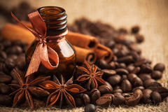 Bottle coffee aroma oil with aromatic coffee beans Stock Image