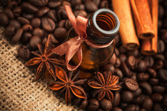 Bottle coffee aroma oil with aromatic coffee beans Stock Photography