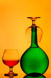 Bottle and cognac glasses Stock Photography
