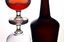 Bottle and cognac glasses Stock Photos