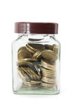 Bottle of Coins. On White Background Stock Photos