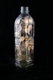 Bottle with coins Royalty Free Stock Photo