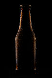 Bottle of cold beer on black background Royalty Free Stock Photos