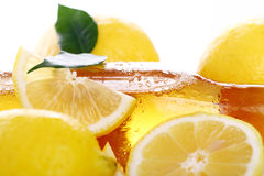 Bottle of cold beer with fresh lemons Stock Images