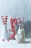 Bottle of cold milk and Christmas candy Stock Photo