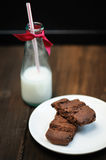 Bottle of Cold Milk with  Straw; Chocolate Cake in foreground Stock Images