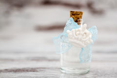 Bottle of Cologne with Blue Lace Prepared as a Gift for Baby Sho Royalty Free Stock Photos
