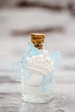 Bottle of Cologne with Blue Lace Prepared as a Gift for Baby Shower royalty free stock photos