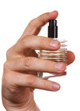 Bottle of cologne in his hand Royalty Free Stock Photography
