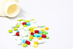 A bottle of colorful pills Stock Photography