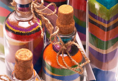 Bottle with colorful sand Royalty Free Stock Images