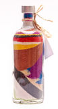 Bottle with colorful sand Royalty Free Stock Image