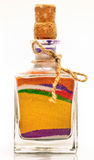 Bottle with colorful sand Stock Image