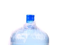 Bottle for cooler in plastic packet. Stock Photos