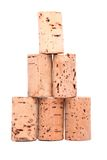 Bottle corks - pyramid. Close-up on the white background Stock Photos