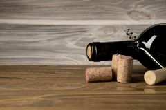 Bottle, corkscrew and cork are on the table royalty free stock photos