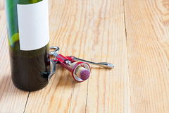 Bottle with corkscrew Royalty Free Stock Photography